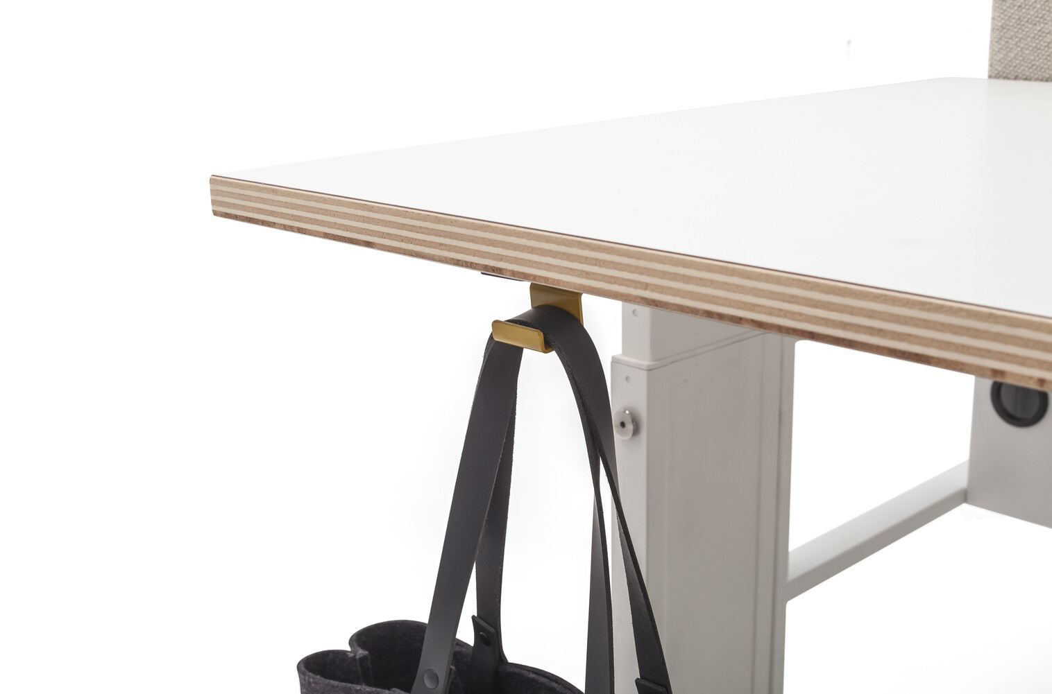 Gispen Cimo dual table with white frame with white plywood tabletops and grey upholstered screen straight rounded thick with baghook and bag front right detail view