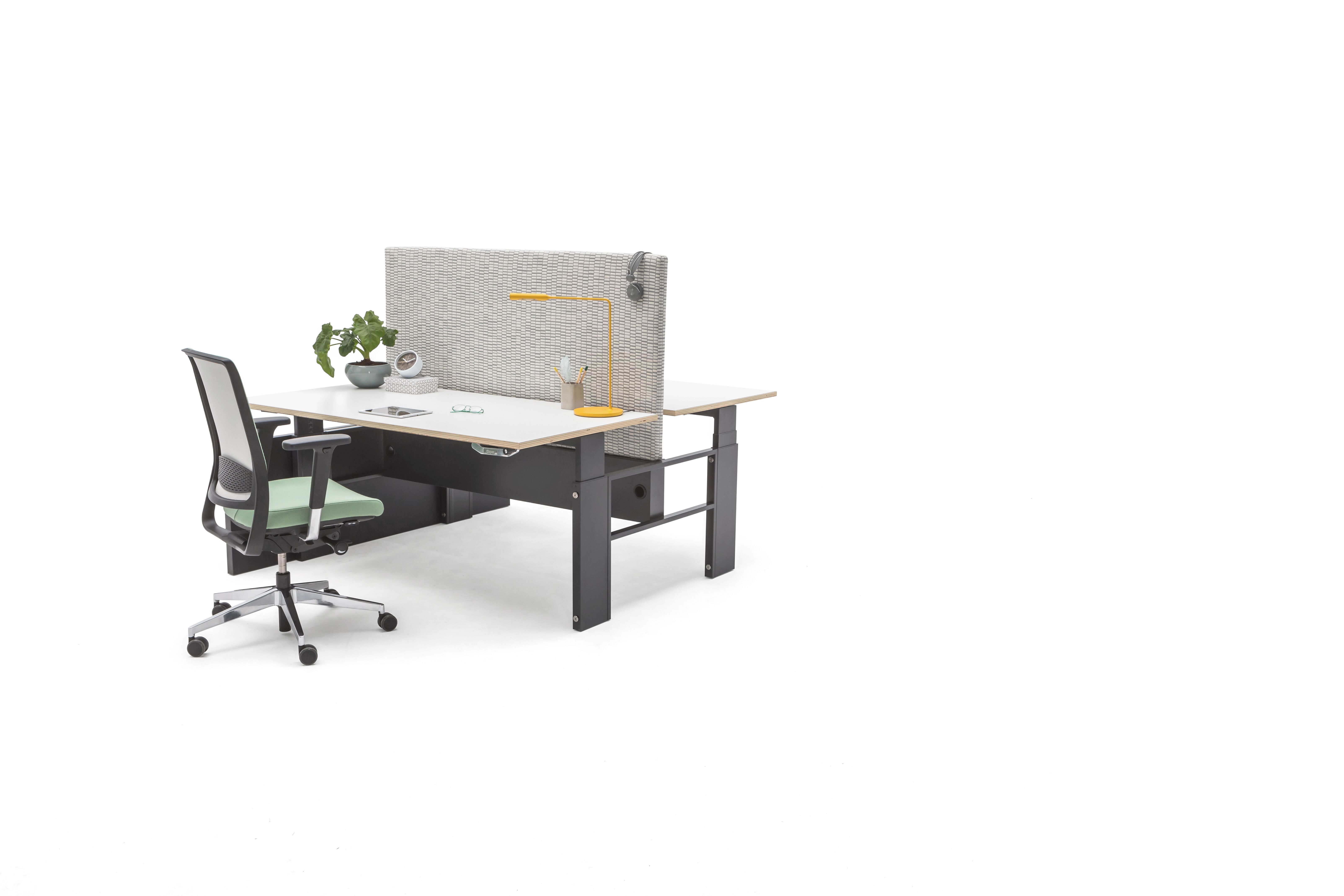 Gispen Cimo dual table with anthracite frame and black wooden dual panel leg left with white plywood tabletops with grey upholstered screen straight rounded thin and green Zinn office chair front right view