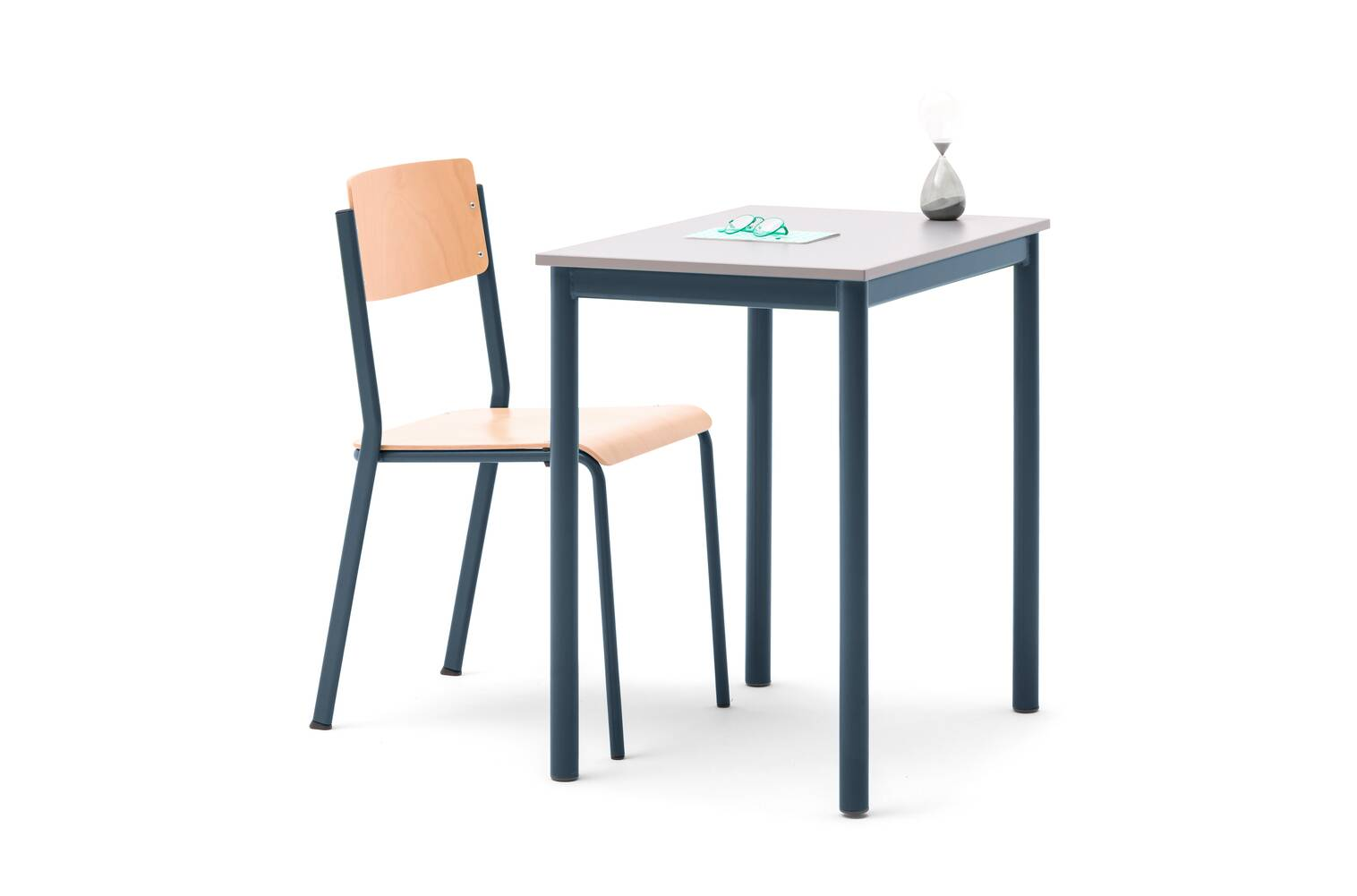 Gispen EDUU Classic table with green frame and grey tabletop with green EDUU Retro chair with styling front left view