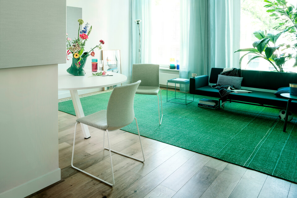 Royal Ahrend Well sled base chairs upholstered in green at Kvadrat store in Amsterdam DSF3245