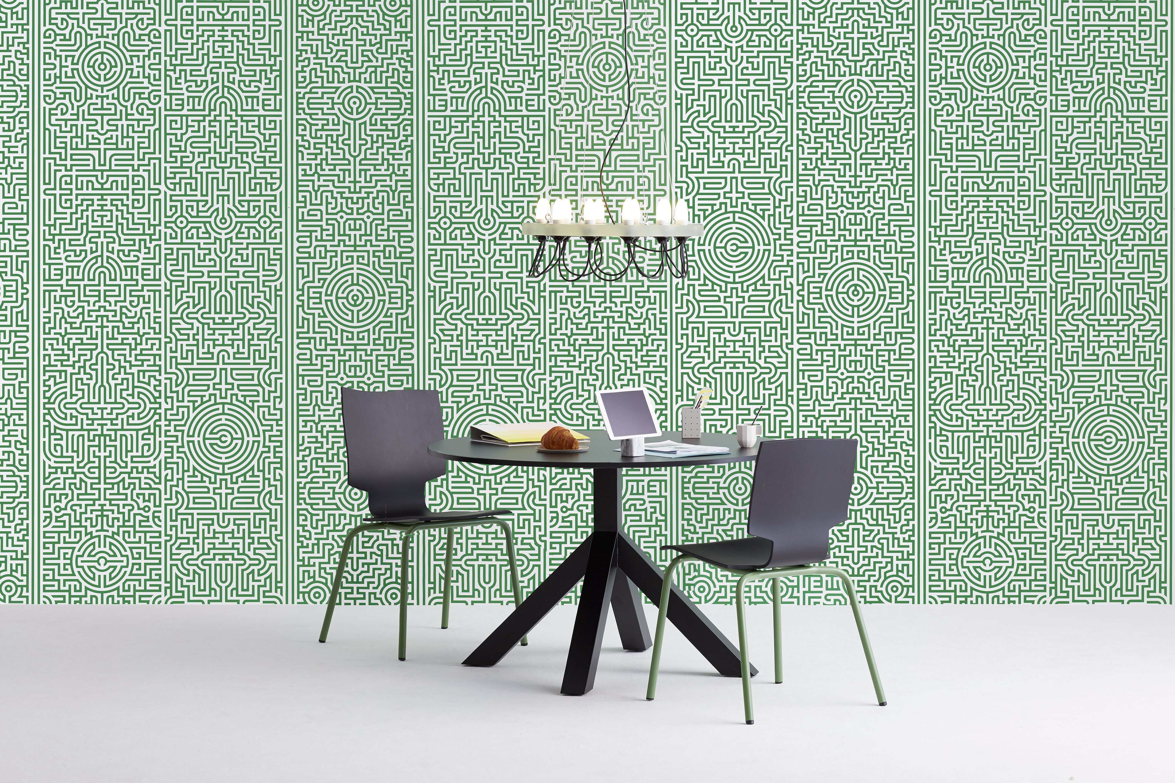 Gispen Dukdalf table with black frame and black tabletop with More or Less chair and Centraal Museum chandelier with tablet in front of green patern background front view