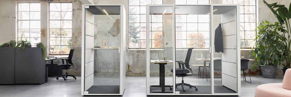 Ahrend Qabin booth and space in space with Ease office chair and black desk with Balance SDK Recharge and Well in a Hybrid working community setting