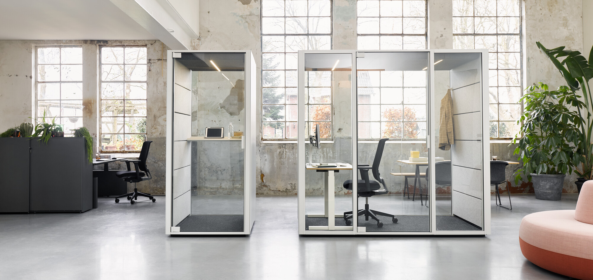 Ahrend Qabin booth and space in space with Ease office chair and white desk with Balance SDK Recharge and Well in a Hybrid working community setting