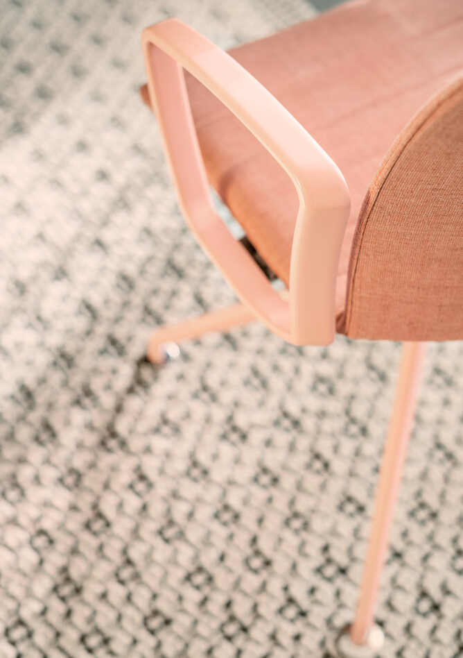 Royal Ahrend Well trestle base chair fully upholstered in pink at Kvadrat store in Amsterdam L1000574