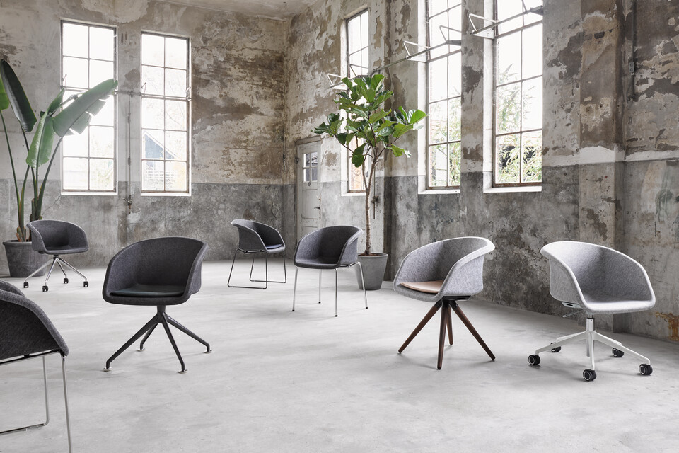 Ahrend Well felt armchairs with different frames in industrial setting