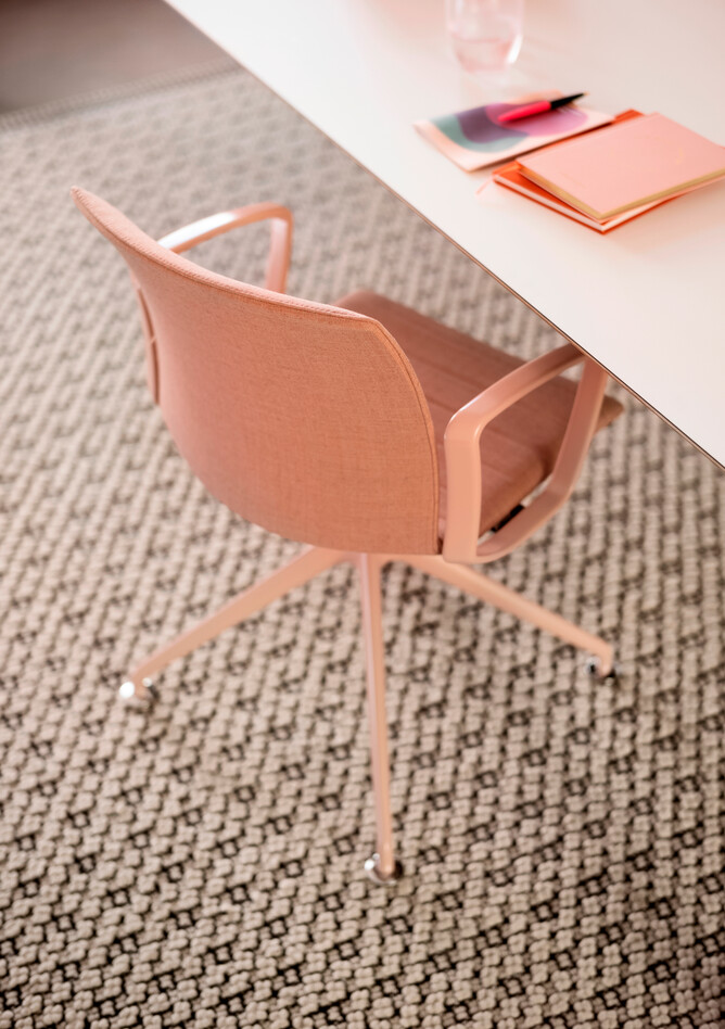Royal Ahrend Well trestle base chair fully upholstered in pink at Kvadrat store in Amsterdam L1000591