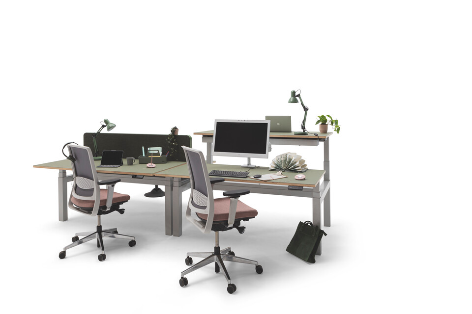 Gispen TMNL dual workstation 3 stage sit stand in light grey with green tops and green screen with Zinn office chairs front right view