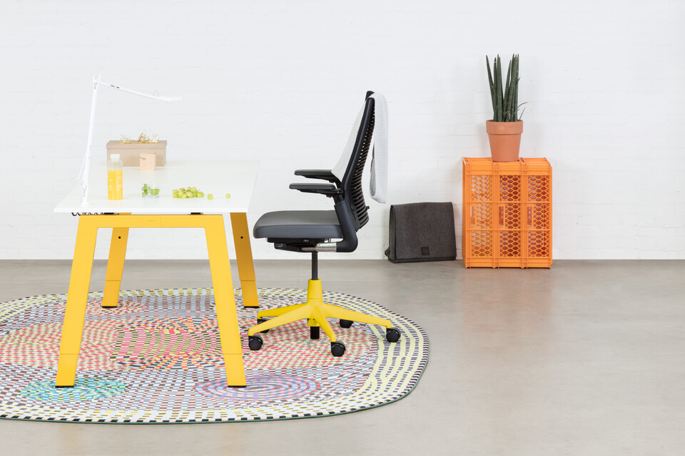 Royal Ahrend Balance 4 leg workstation in yellow with white top and grey 2020 office chair with yellow base left side view