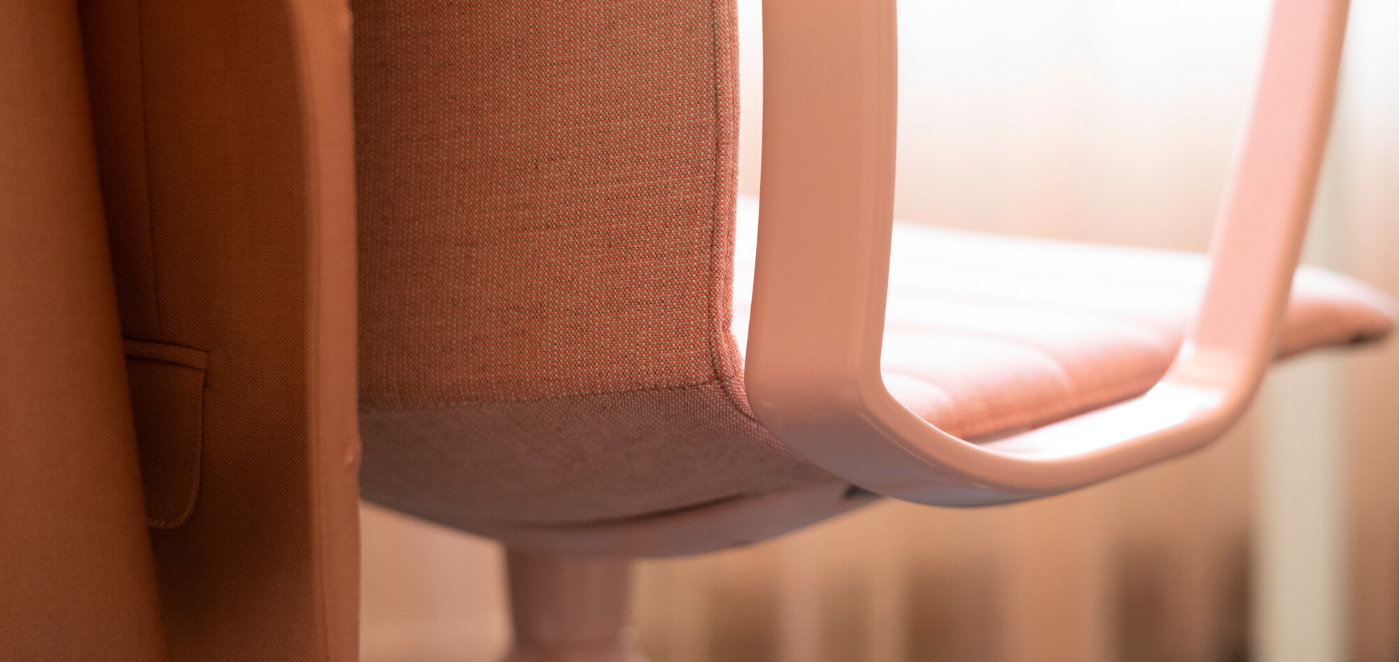 Royal Ahrend Well trestle base chair fully upholstered in pink at Kvadrat store in Amsterdam L1000728