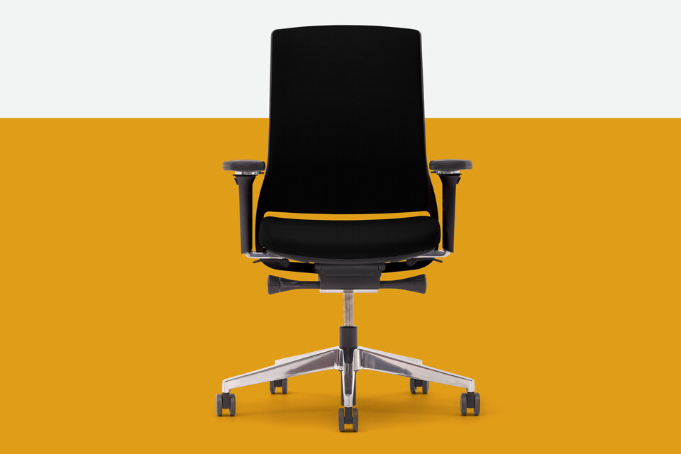 Gispen Zinn office chair upholstered in black with yellow background front view