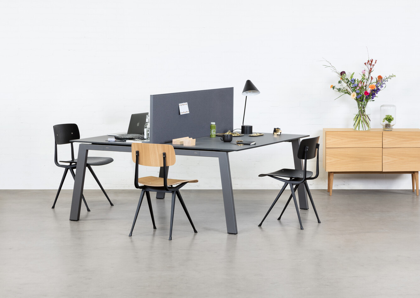 Royal Ahrend Balance 4 leg dual workstation in anthracite with charcoal tops and grey screen with Result chairs front left view