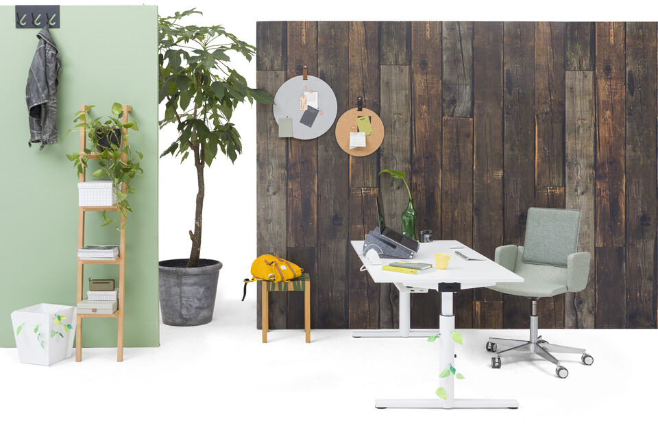 Gispen TM workstation in white with white tabletop and green upholstered Triennial Manage chair in front of brown wooden backpanel left side view