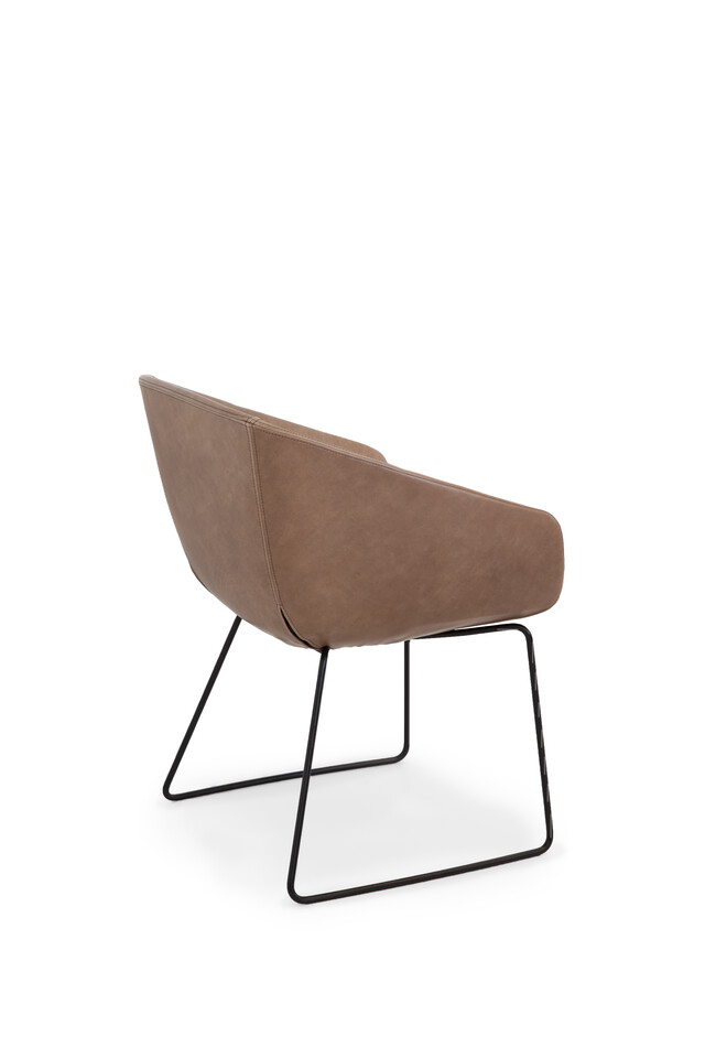 Royal Ahrend Hesta S05 armchair upholstered in brown leather left rear view