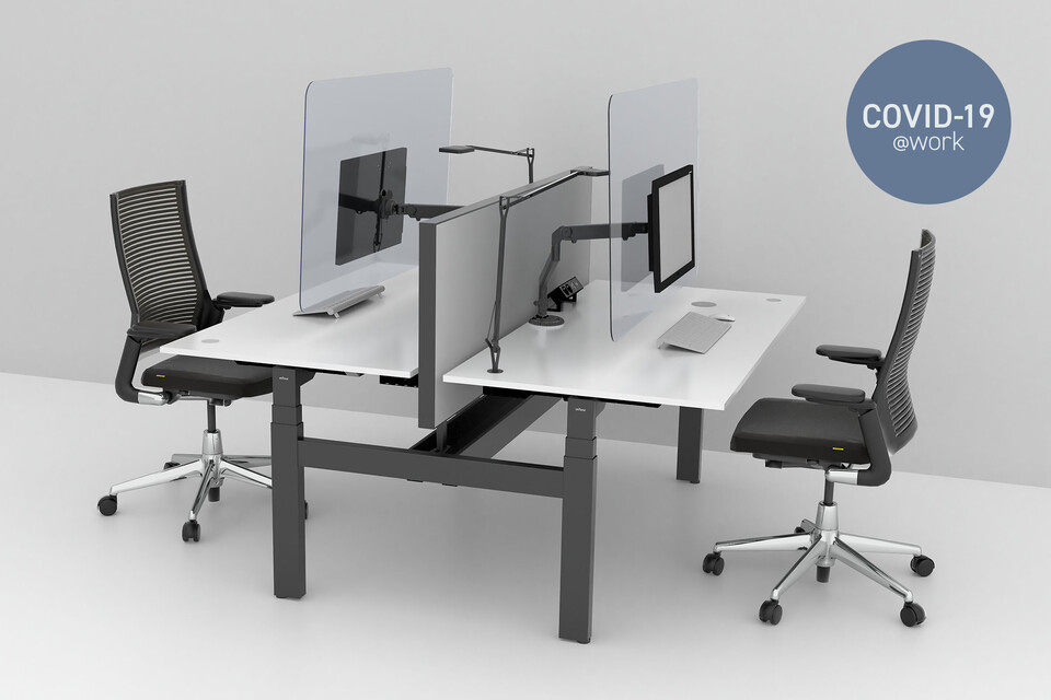 Large Royal Ahrend Balance dual desks in grey with transpartent screens and 2020 Extra Verta office chairs front left view with Covid 19 label