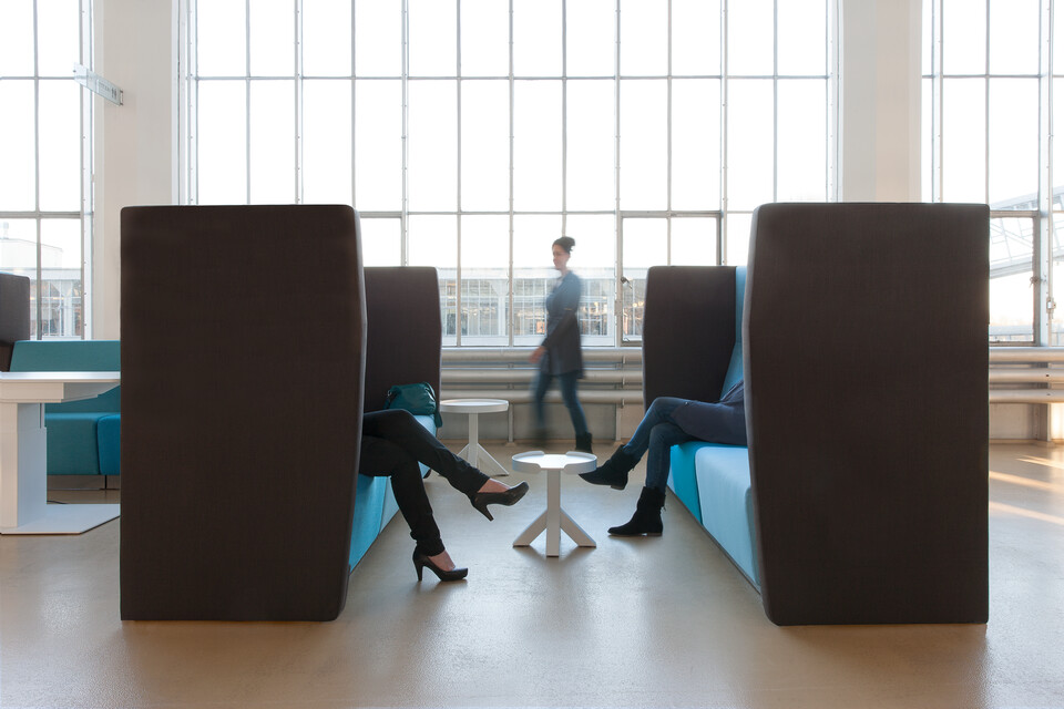 Gispen MultiLounge modular seatings with Closed sidewalls and Dukdalf sidetables with people sitting and walking at Van Nelle Factory in Rotterdam