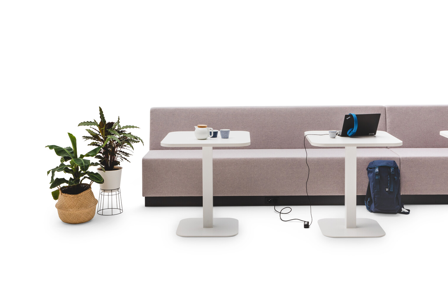 Gispen JUNA Single low trainbench upholstered in grey with 2 white KOLM column tables and styling front view