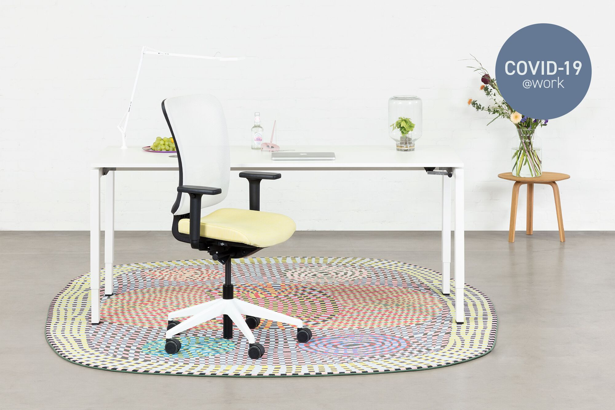 Large Royal Ahrend Balance 4 leg in white with yellow and white SQALA office chair with karpet front view with Covid 19 label