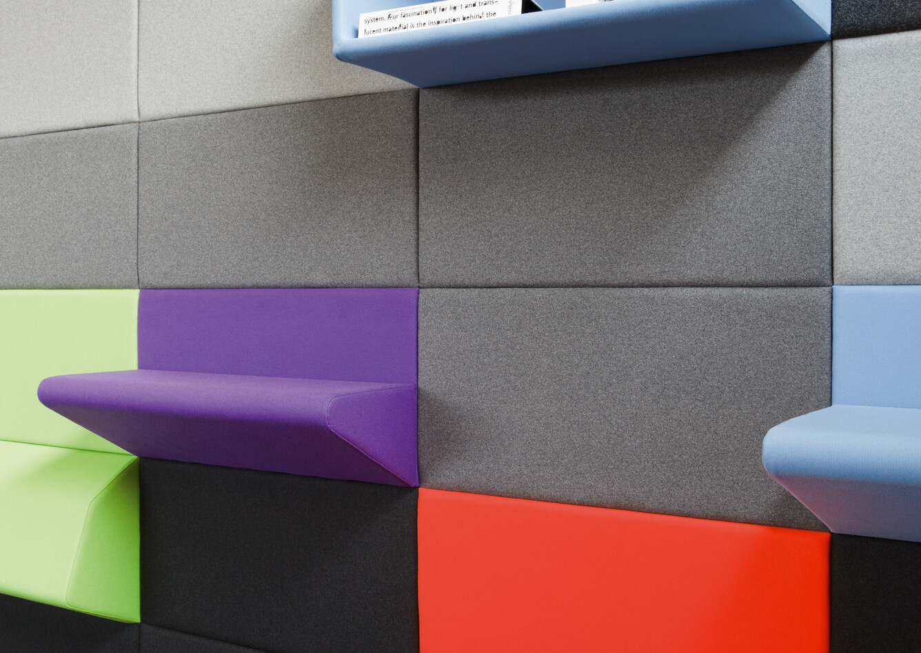 Royal Ahrend Living Wall panels upholstered in grey with coloured seating and armrest panels with blue open cabinet front right view