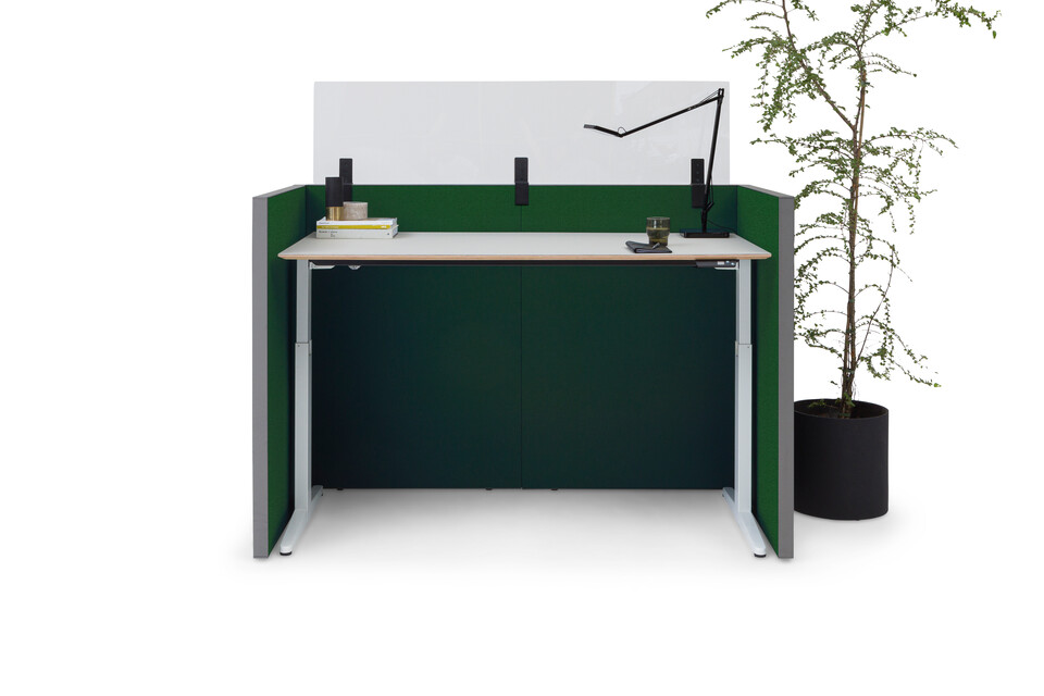 Royal Ahrend Retreat Acoustic screen with grey frame and upholstered in green with Balance desk in white in standing position Ahrend Clear transparent screen styled front view