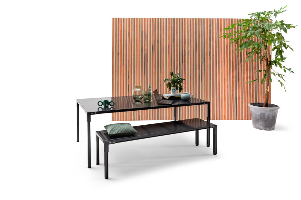 Remady by Gispen Picknick table and bench in black in front of brown wood patern backpanel front left view