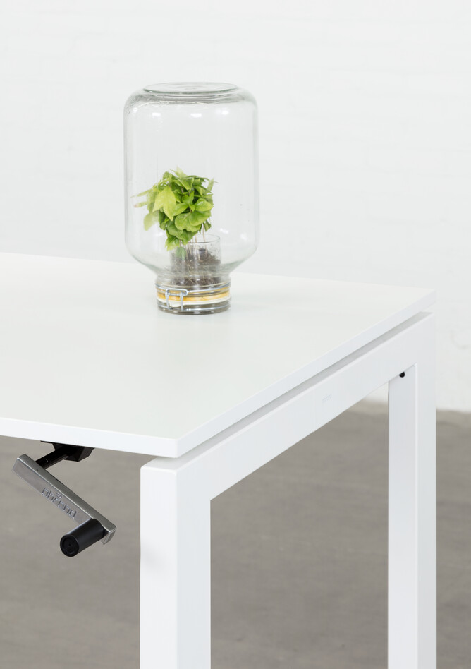 Royal Ahrend Balance 4 leg in white with crank and glass jar with plant front right detail view