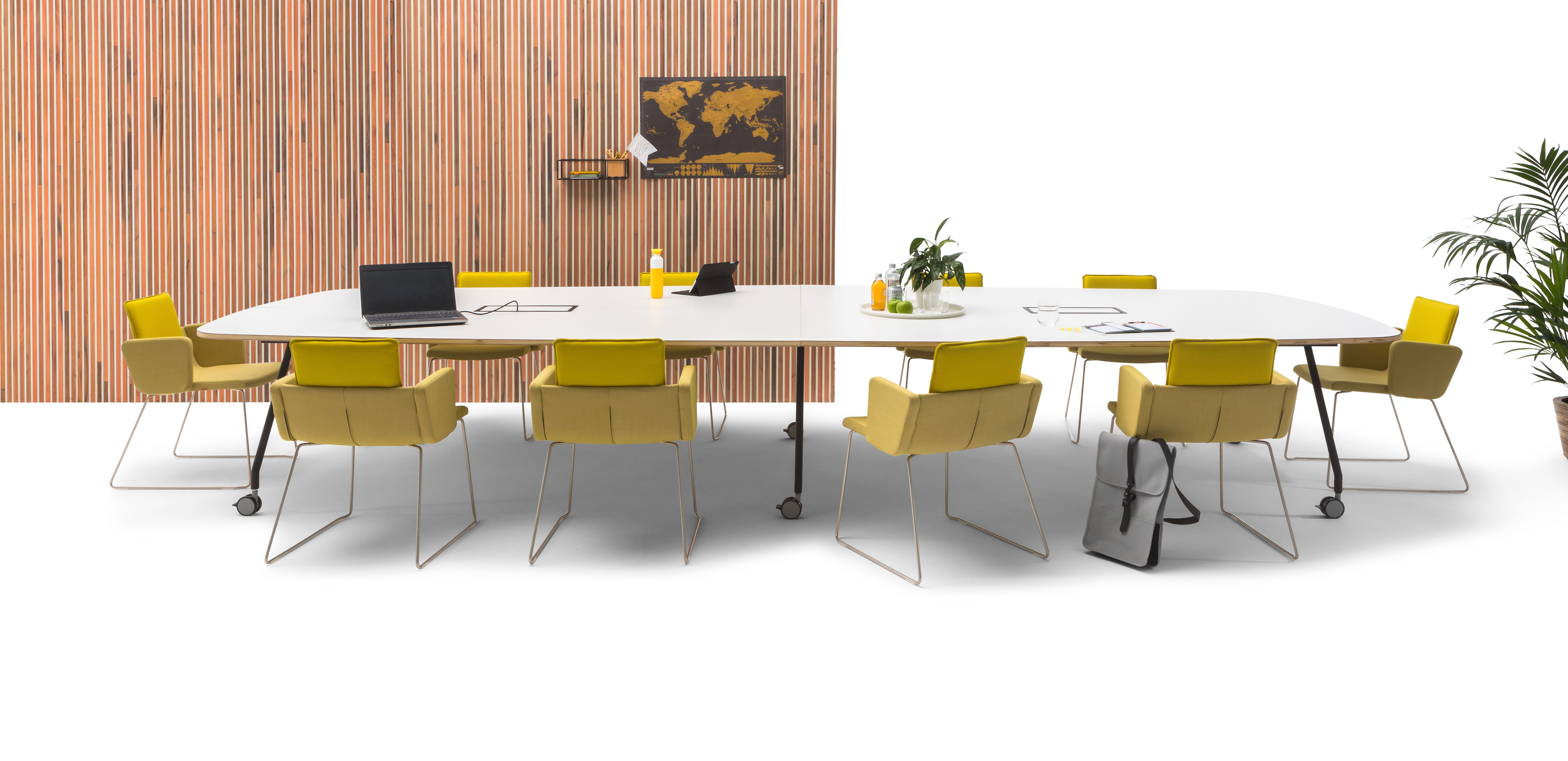 Gispen TEAM Project wheels conference table with black legs and frame with white tabletop with yellow Triennial Project chairs and scrapwood backpanel front view