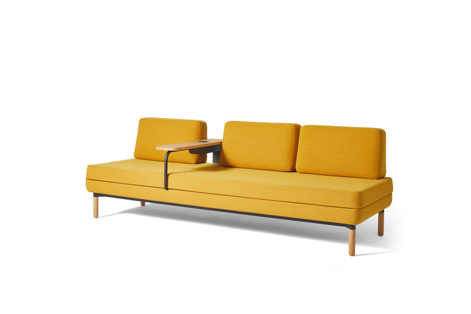 Gispen STEE sofa in black upholstered in yellow with oak table and PuK front right view