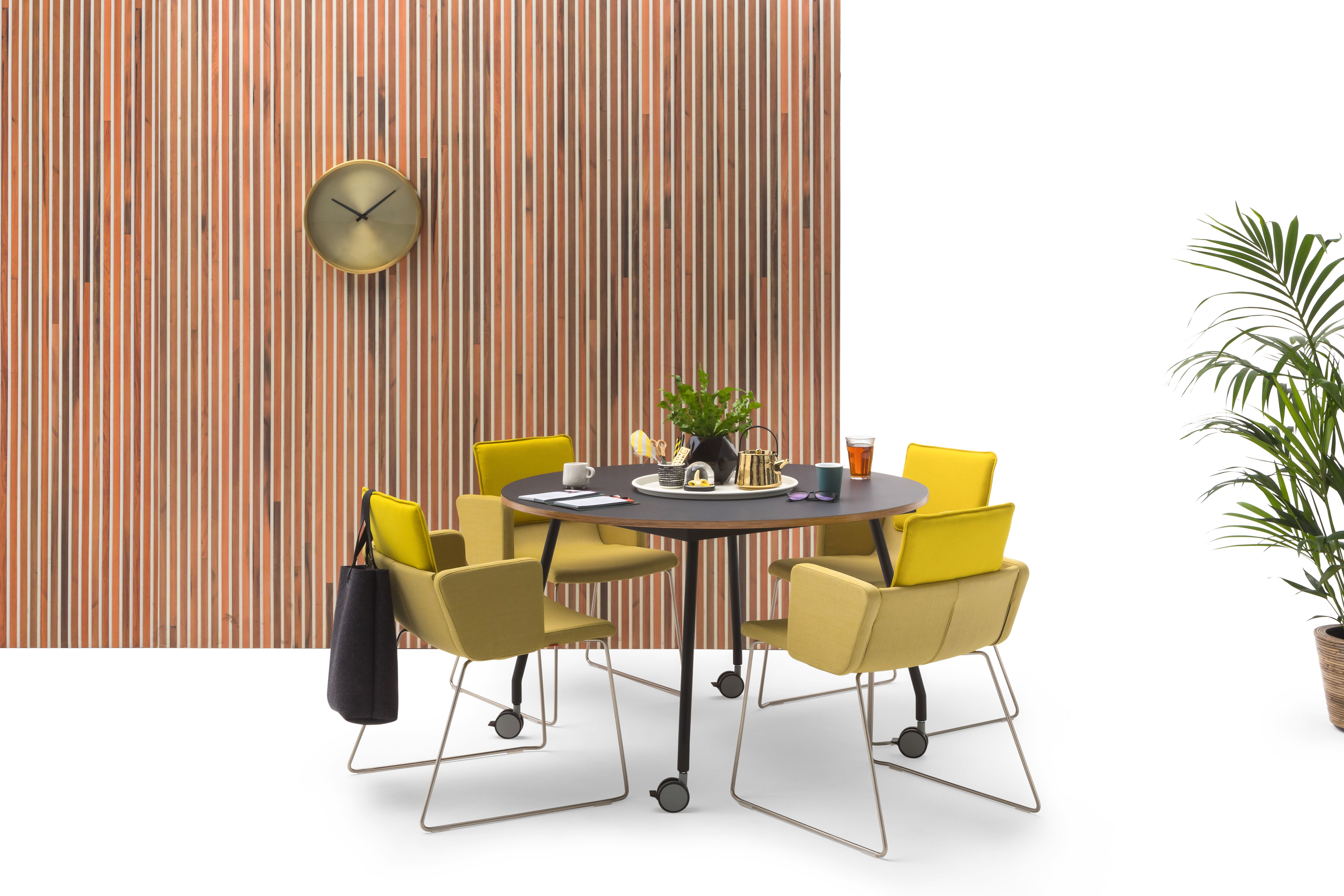 Gispen TEAM Project wheels conference table with black legs and frame and tabletop with yellow Triennial Project chairs and scrapwood backpanel front view