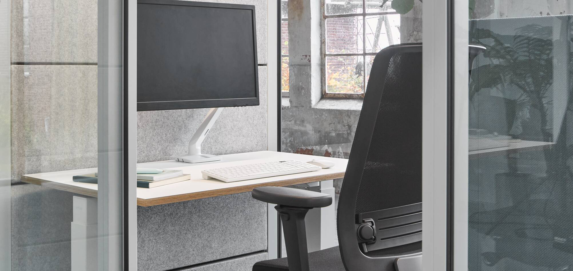 Ahrend inside of Qabin with Ease office chair and desk in a Hybrid working community setting