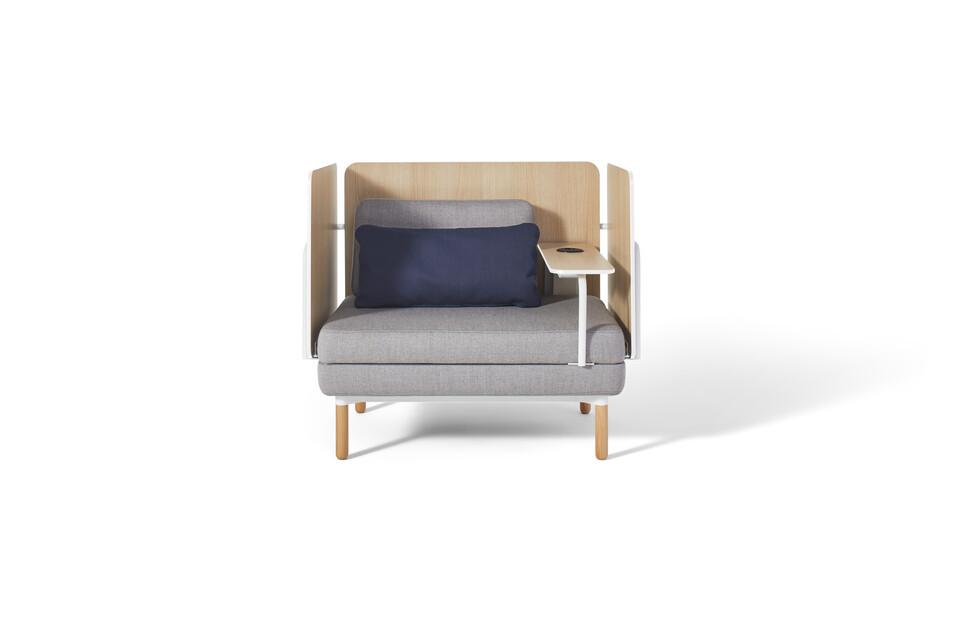 Gispen STEE armchair in white upholstered in grey with oak table and power socket front view