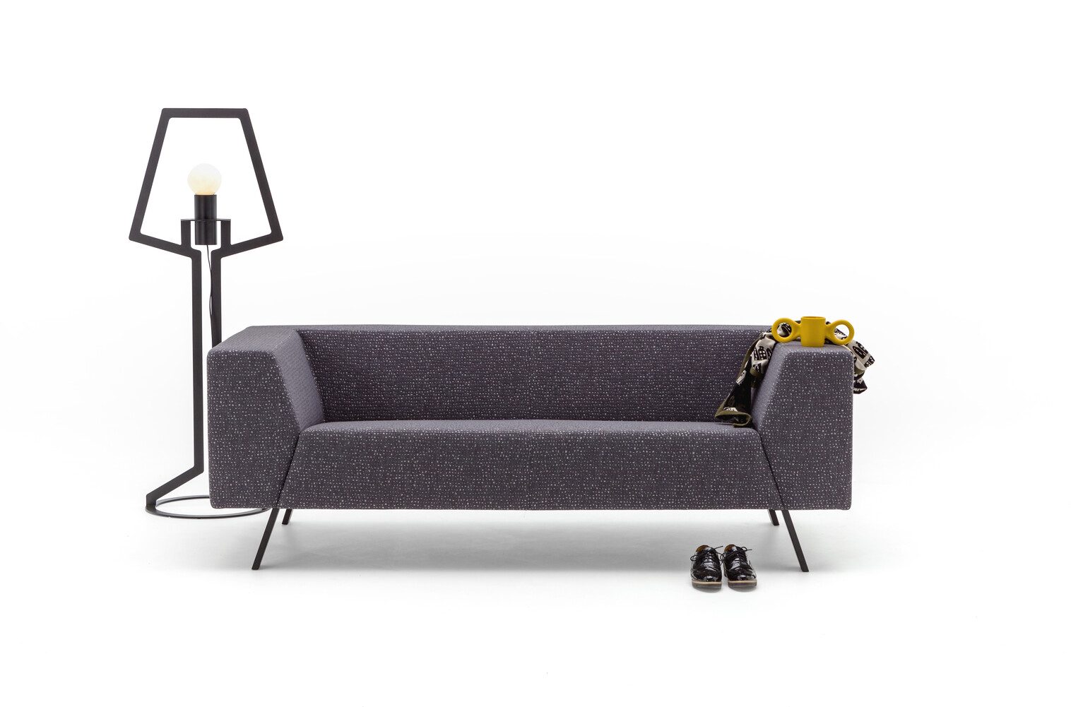 Gispen Sett low 3 seat sofa in galaxy 178 anthracite with Oultine floorlamp and dombo cup front view