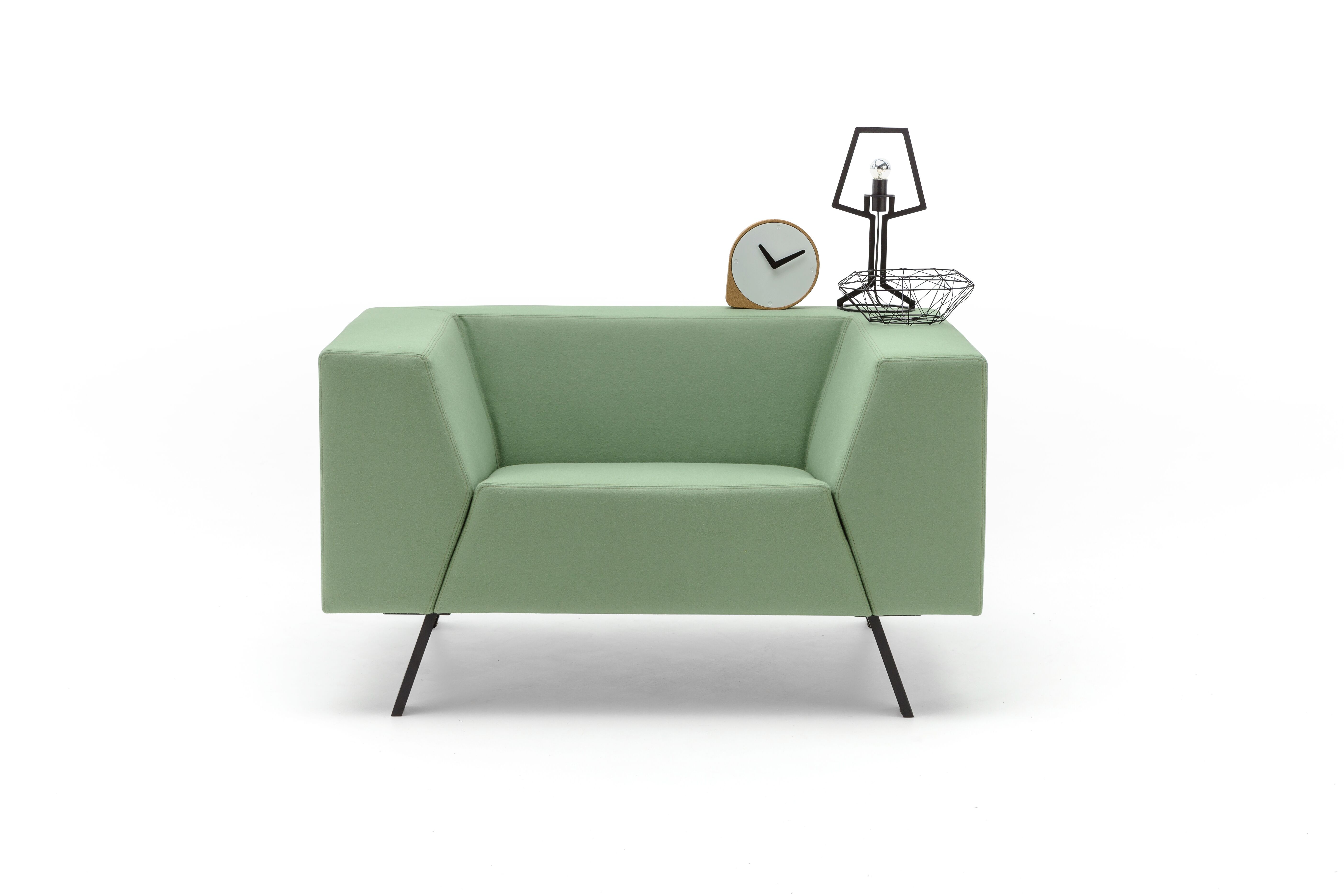 Gispen Sett low armchair in divina 856 green and Outline table lamp front view