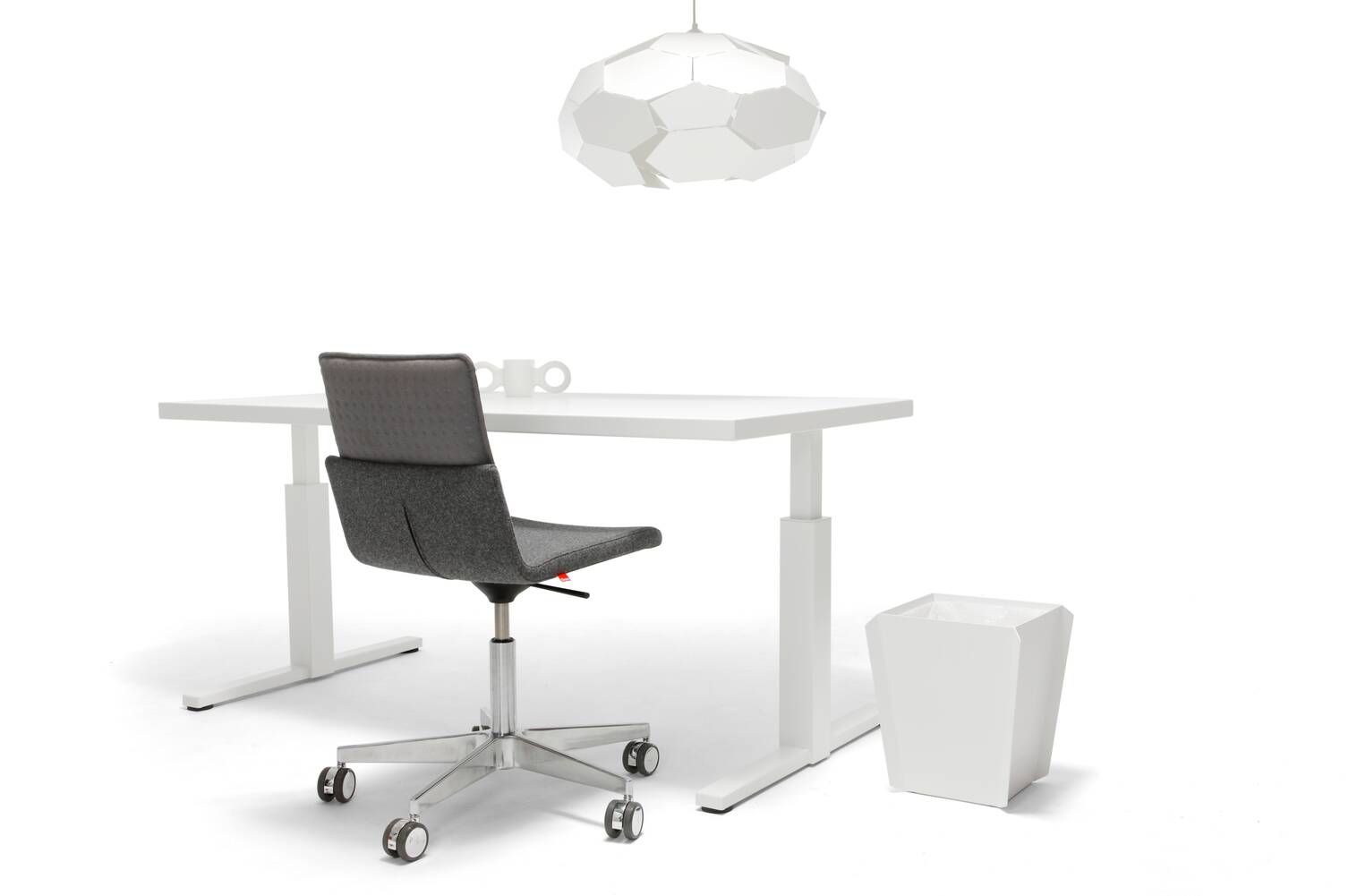 Gispen SteelTop T legged table with pure white RAL 9010 frame and tabletop and Triennial Work office chair with white Binit wastebin and Thunderball pendant lamp front right view