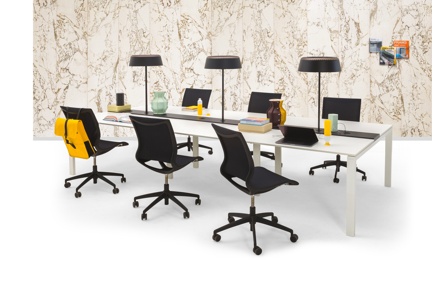 Gispen IC bench in white with black Turn chairs and Ring T1 tablelamp with marble backpanel front right view