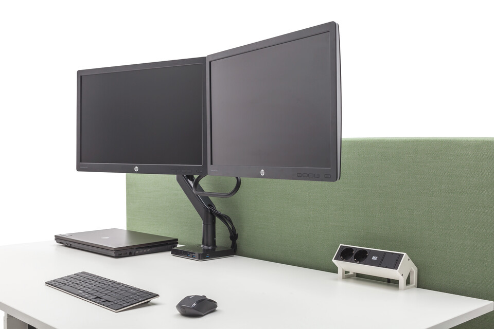 Gispen Cimo dual table with white chipboard tabletop and green upholstered screen straight thin and dual monitor setup and netbox wth laptop keyboard and mouse front right detail view