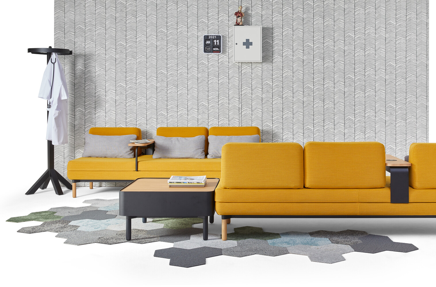 Gispen STEE sofas in black upholstered in yellow with black coffee table and oak top with black Dukdalf coat stand front view