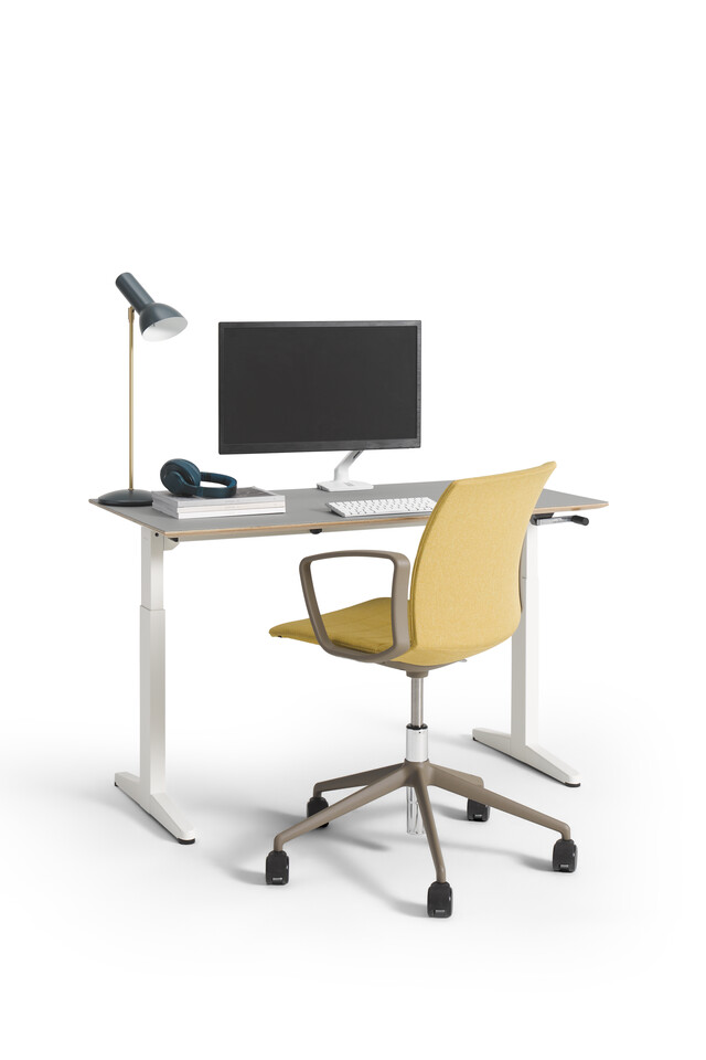 Royal Ahrend Balance desk in white with beige tabletop and grey Well chair upholstered in yellow styled front left view