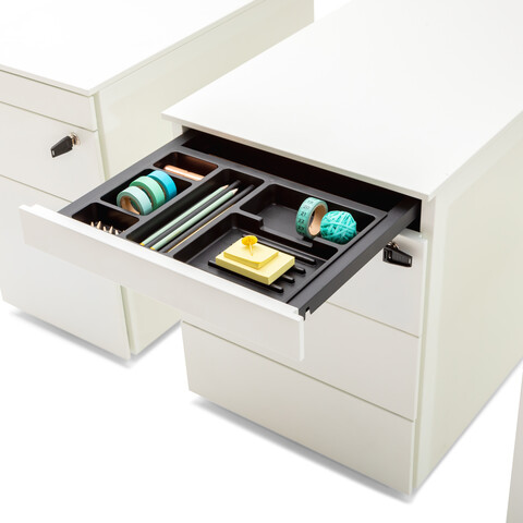 Royal Ahrend Pedestals in white with open pen trays and turquoise office supplies front right detail view