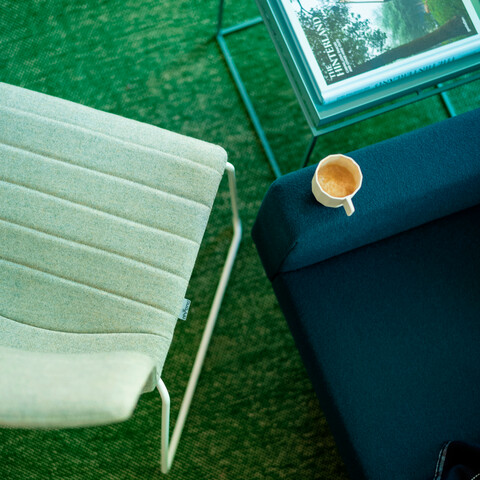 Royal Ahrend Well sled base chair fully upholstered in green at Kvadrat store in Amsterdam L1000870