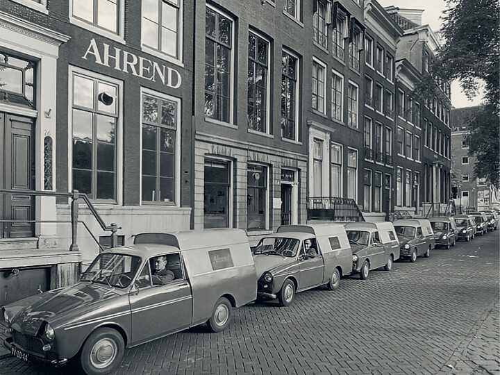 Ahrend buidling in Amsterdam with company cars in front