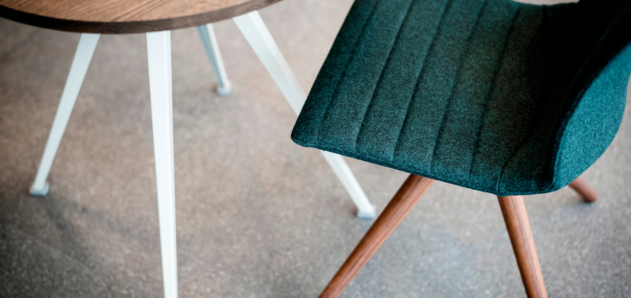 Royal Ahrend Well trestle wood base chair with grey shell and green front upholstered at Caffe Dallucci in Amsterdam L1000965