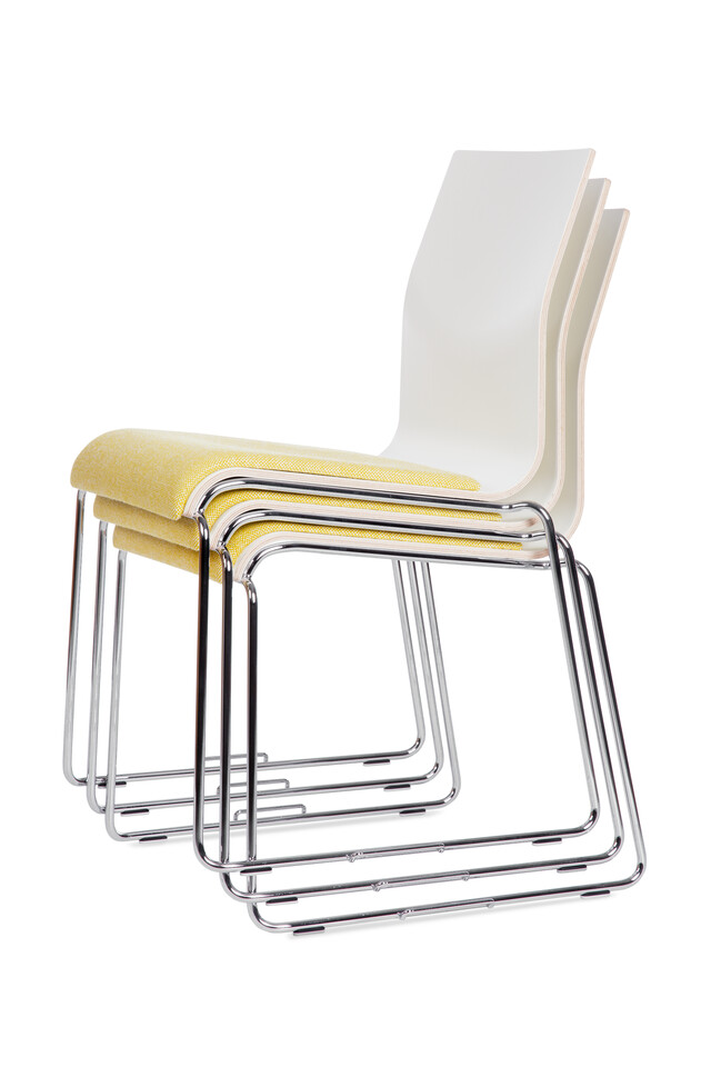 Royal Ahrend 370 wireframe chairs with chrome legs and shell in white with seat upholstered in yellow stacked 3 high front right view