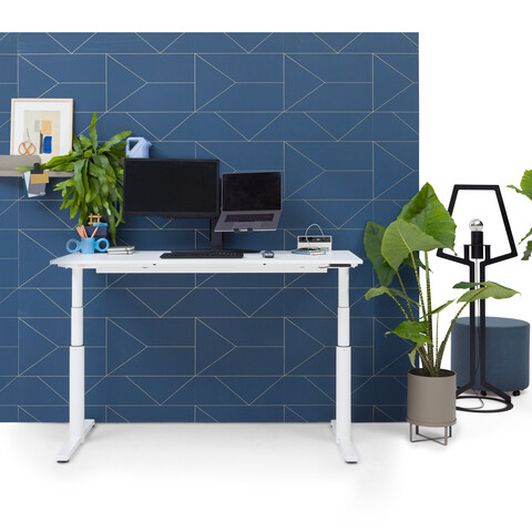 Gispen TM workstation in white with white tabletop in stand position in front of blue backpanel front view