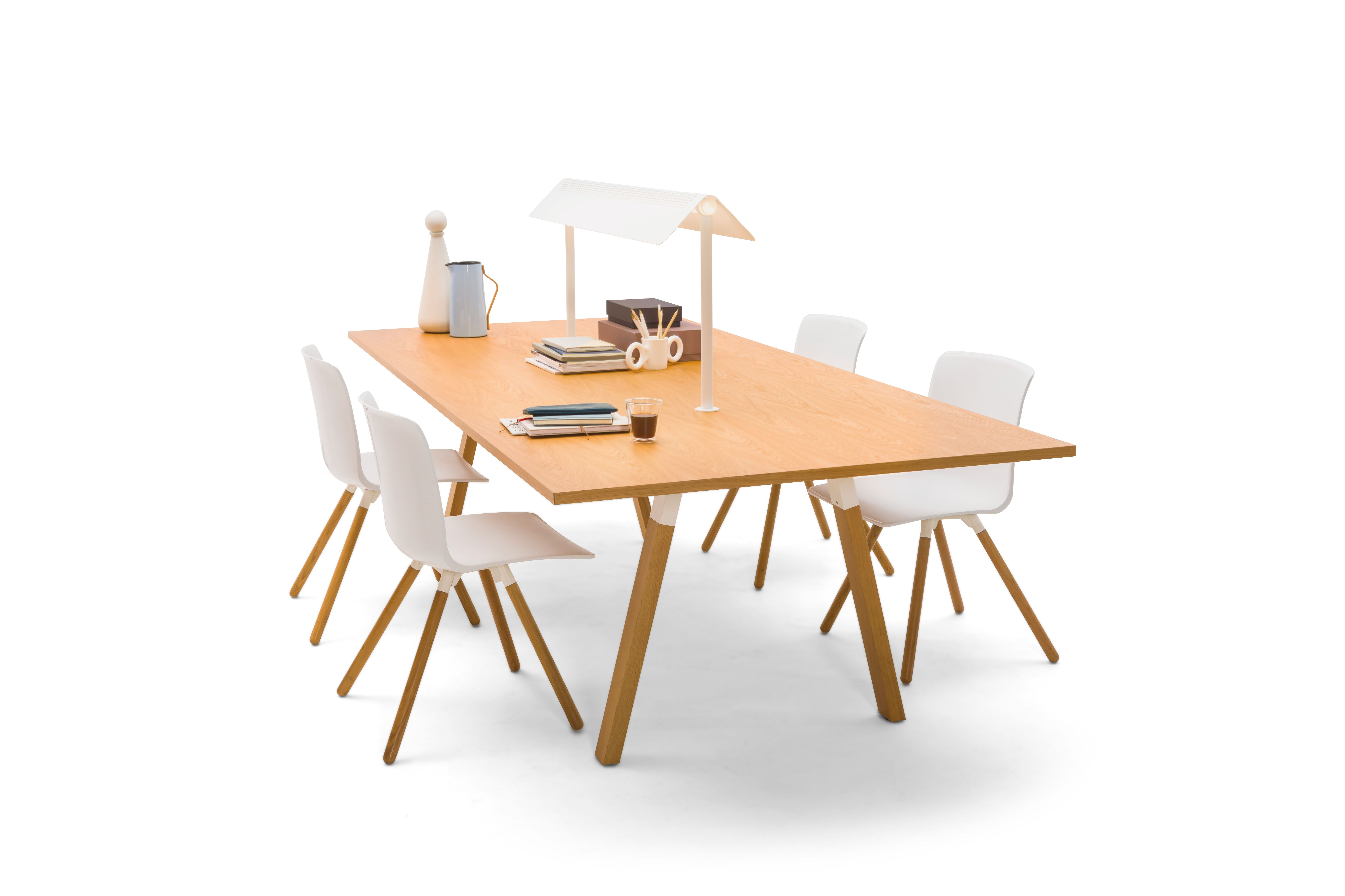 Gispen TEAM Wood rectangle conference table with diagonal oak legs and tabletop with white Nomi Wood chairs with styling front right view